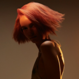 Artful Feeling Model With Pink Crimped Bob