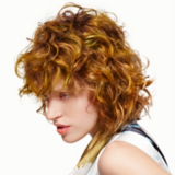 Artful Feeling Model With Blonde Curly Bob and Fringe