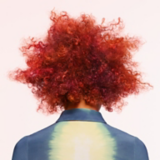 Artful Feeling Back View Of Model With Red Coiled Curls Bob