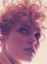 VivID Close Up Of Model With Light Blonde Loose Curls