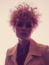 VivID Model With Light Blonde Loose Curls