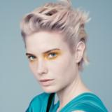 Everyday Decadence Model With Light Blonde Wavy Pixie Cut Portrait