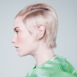 Everyday Decadence Model With Light Blonde Pixie Cut Slicked Back