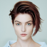 Everyday Decadence Salon Look Model with Brunette Swept Over Pixie Haircut