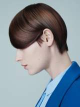 Everyday Decadence Salon Look Side-shot Of Model with Brunette Pixie Haircut