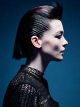 Dark Romance Side Shot of Model With Slicked Back Black Hair