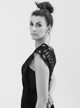 Dark Romance Model Looking Back With Dark Brown Hair In Messy Topknot