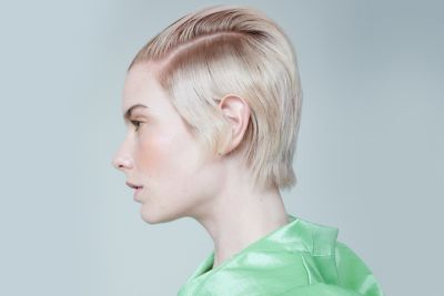 Essential Looks Everday Decadence Julianna Model With Light Blonde Pixie Cut