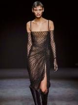 Dark Romance Model with Short black Pixie Cut Wearing Sheer Dress