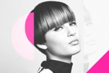 Education Black and White Image of Model With Brunette Pixie Cut
