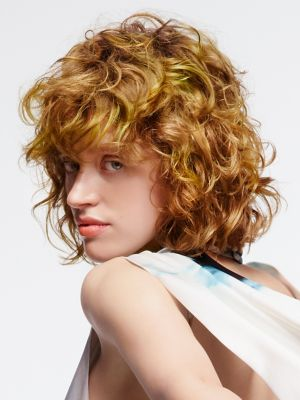 Essential Looks Artful Feeling Model With Blonde Curly Bob and Fringe
