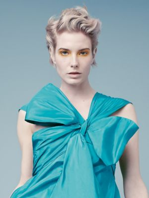 Everyday Decadence Model With Wavy Blonde Pixie Cut