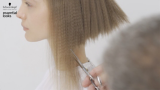 Essential Looks Artful Feeling Model With Blonde Crimped Hair Being Cut