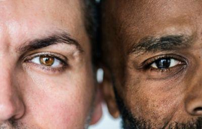 Two different ethnic men eyes closeup