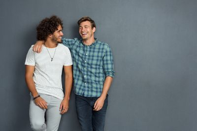 Young men with short hair and beard laughing
