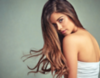 Brunette woman with long hair and side part