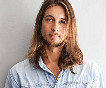 Male model with long slick-backed hairstyle