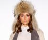 Brunette model wears wavy hairstyle with winter hat