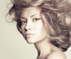 Model wears curly updo hairstyle with dry shampoo