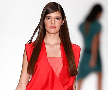 model with long hairstyle walks down the catwalk