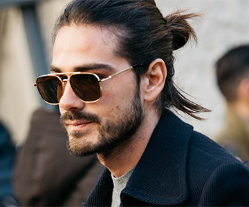 A man with a man bun hairstyle