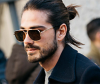 A man with a man bun hairstyle
