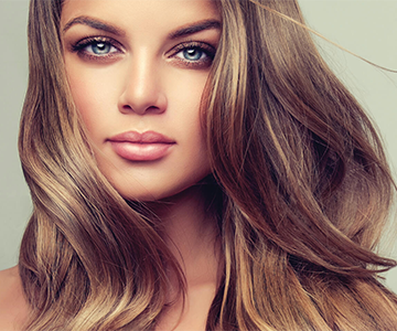 Woman with shiny brown wavy hairstyle