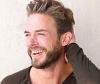 smiling man with bradley cooper hairstyle