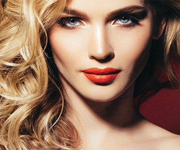 Models wear sleek straight hairstyles in side parting