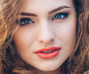 Woman models beautiful frizzy hairstyle