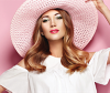 Model creates sleek straight hairstyle with straightening iron