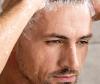 man shampooing hair