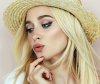 Model wears sun hat to protect hair in summer