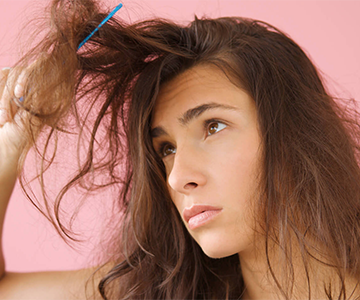 Model shows how to blowdry hair properly