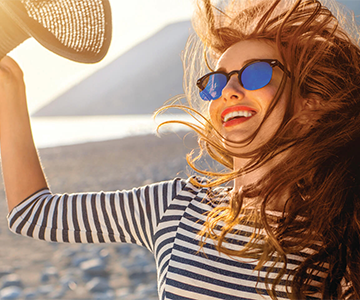 Woman wears hat to protect hair from sun