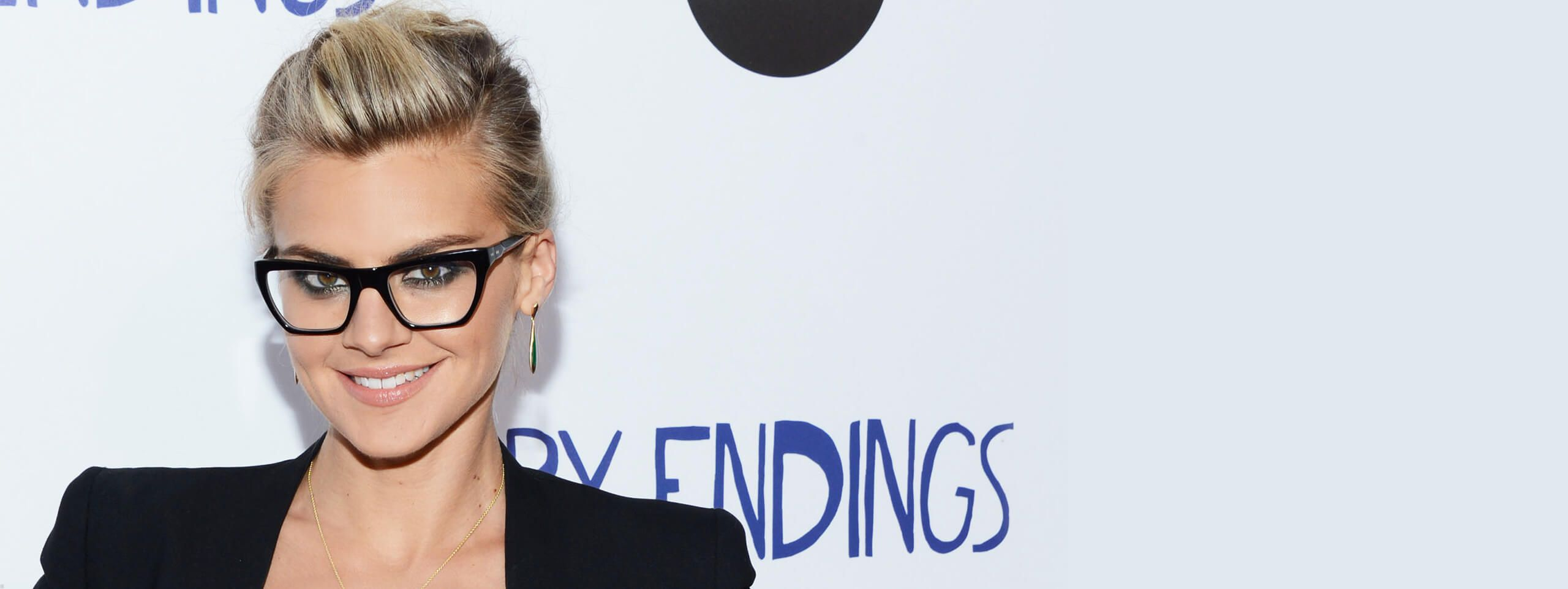 Actress Eliza Coupe wears updo hairstyle with glasses
