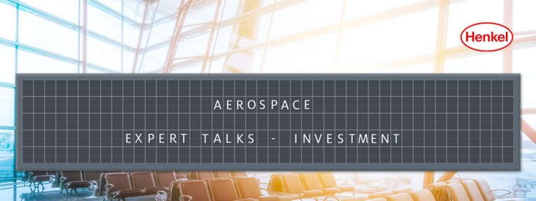 Airport waiting area with departure board showing the name of the article: Aerospace Expert Talks - Investment