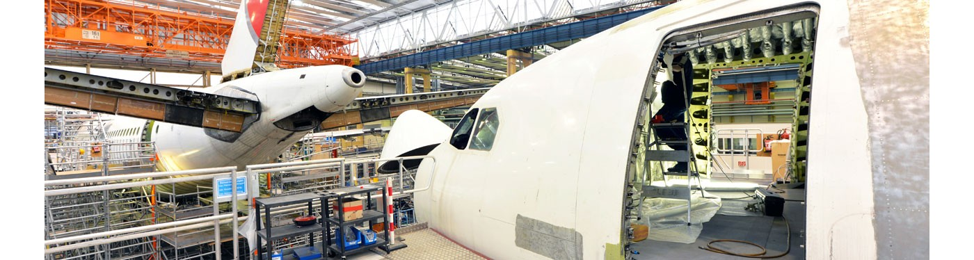 Aircraft nose cone and fuselage door secondary structures in construction hanger represents high performance aerospace manufacturing solutions gettyimages ID 578190333
