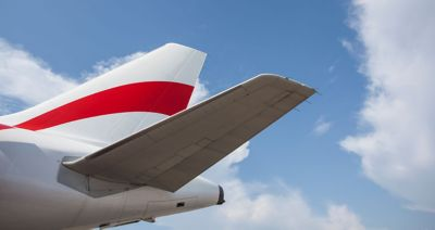 Aircraft tail representing primary aerodynamic structure with critical properties for flight white with red stripe and blue sky backround with white clouds cropped istosckphoto ID 537330664