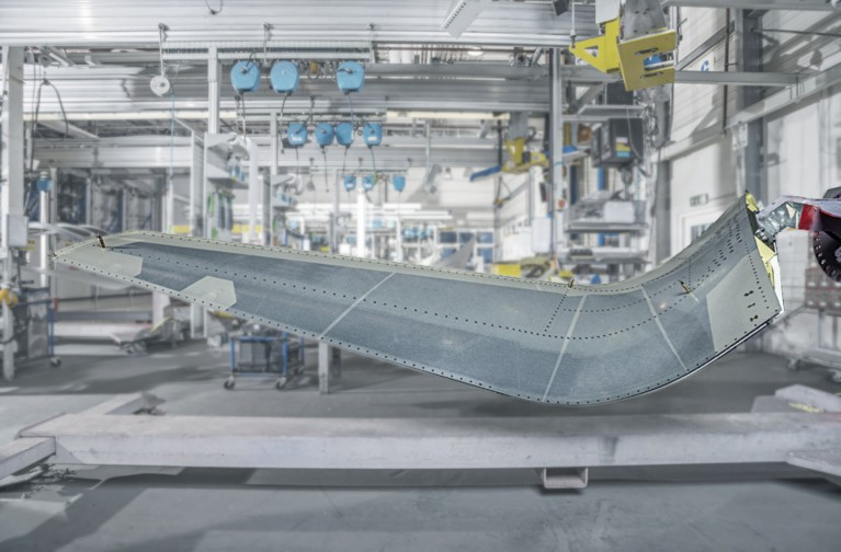 Photo of airplane wing during manufacturing represents structural adhesive solutions for aircraft manufacturing and repair