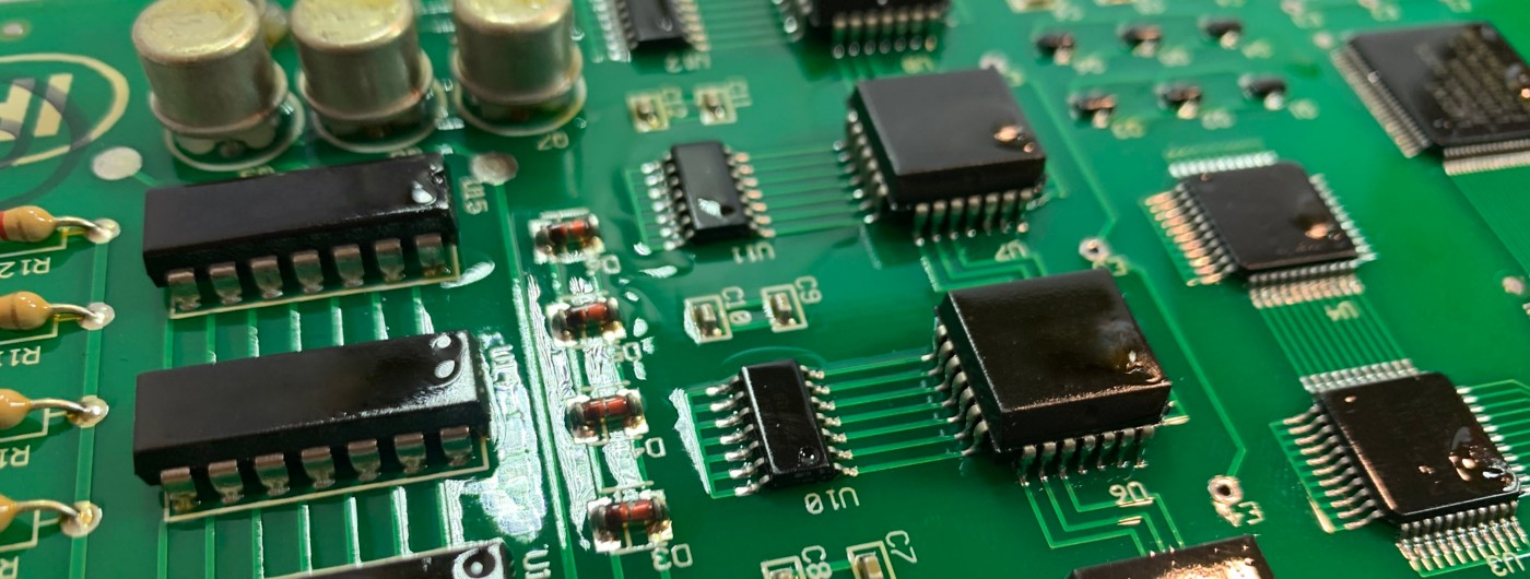 Green printed circuit board with conformal coating on the individual black components