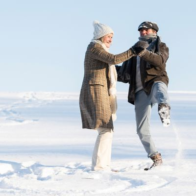 Things to do for Valentine's Day, two people dancing in the snow
