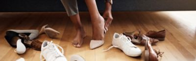Woman trying out different shoes