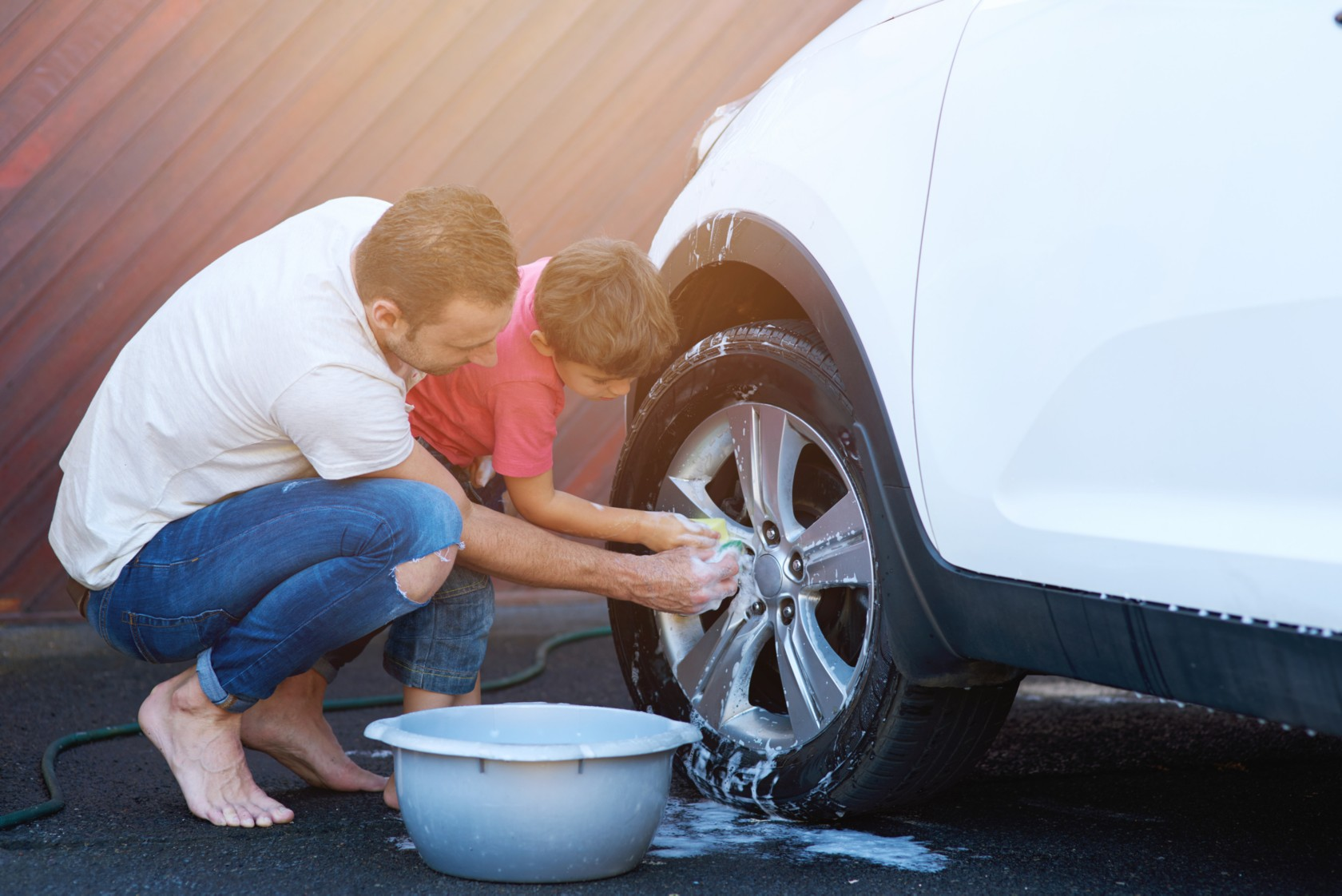 Washing a car with detergent