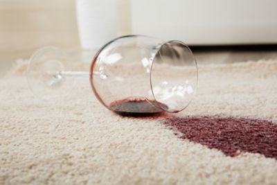 Removing a wine stain from a carpet, a glass of red wine is spilled