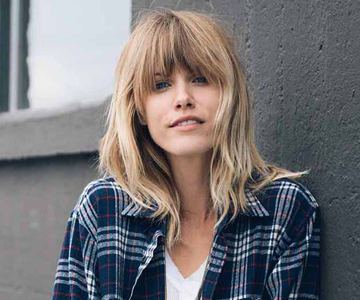Blonde woman with bangs