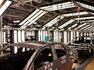 Audi vehicle bodies on the production line during BONDERITE two-step process surface treatment