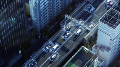 Concept graphic of connected driving and internet of things over cars driving on highway