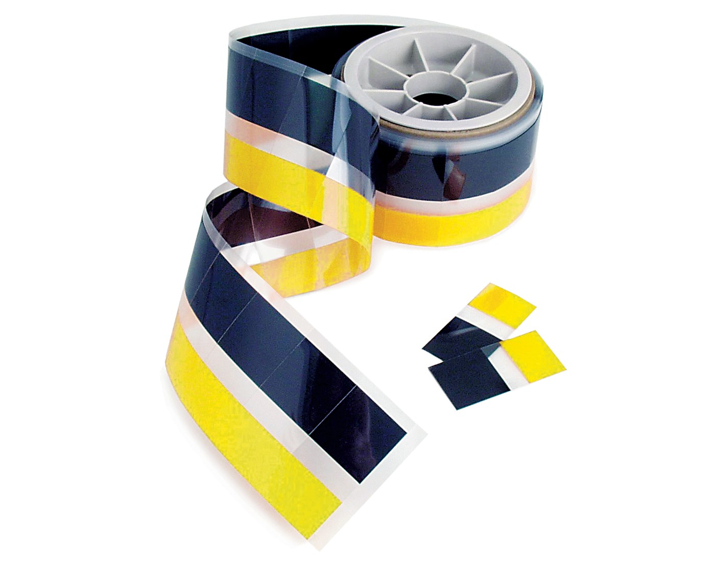 Photo of yellow and black bergquist hi-flow phase change thermal interface material on a spool and cut pieces