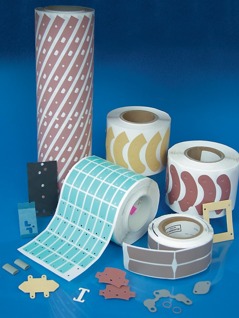 Photo of pre-cut  berguist sil pads on rolls in a variety of shapes, sizes, colors and material formulations represents henkel bergquist solutions for each unique thermal management requirement